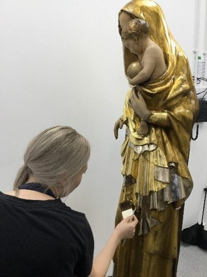 Our Lady of Peace statue being gilded in the Plowden & Smith gilding studio