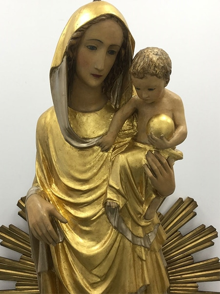 Our Lady of Peace statue after restoration treatment and now freshly gilded in the Plowden & Smith gilding studio