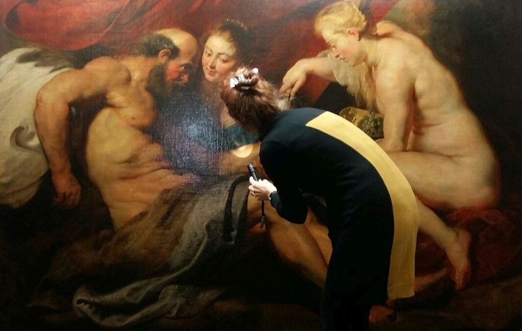 Plowden & Smith art conservators condition checking a painting by Rubens