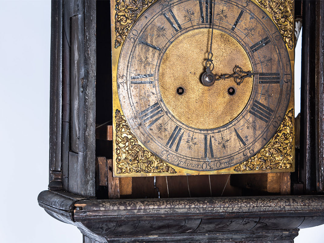 a longcase clock before furniture restoration treatment in the Plowden & Smith furniture restoration studio