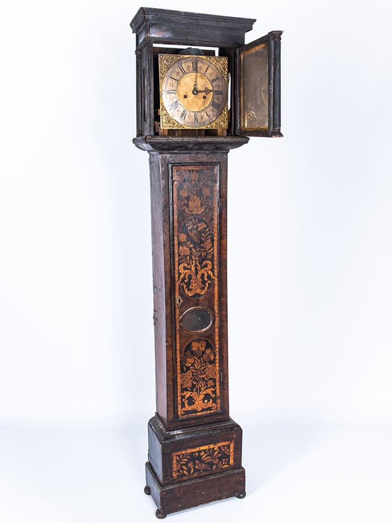 a longcase clock before furniture restoration treatment in the Plowden & Smith furniture restoration studio