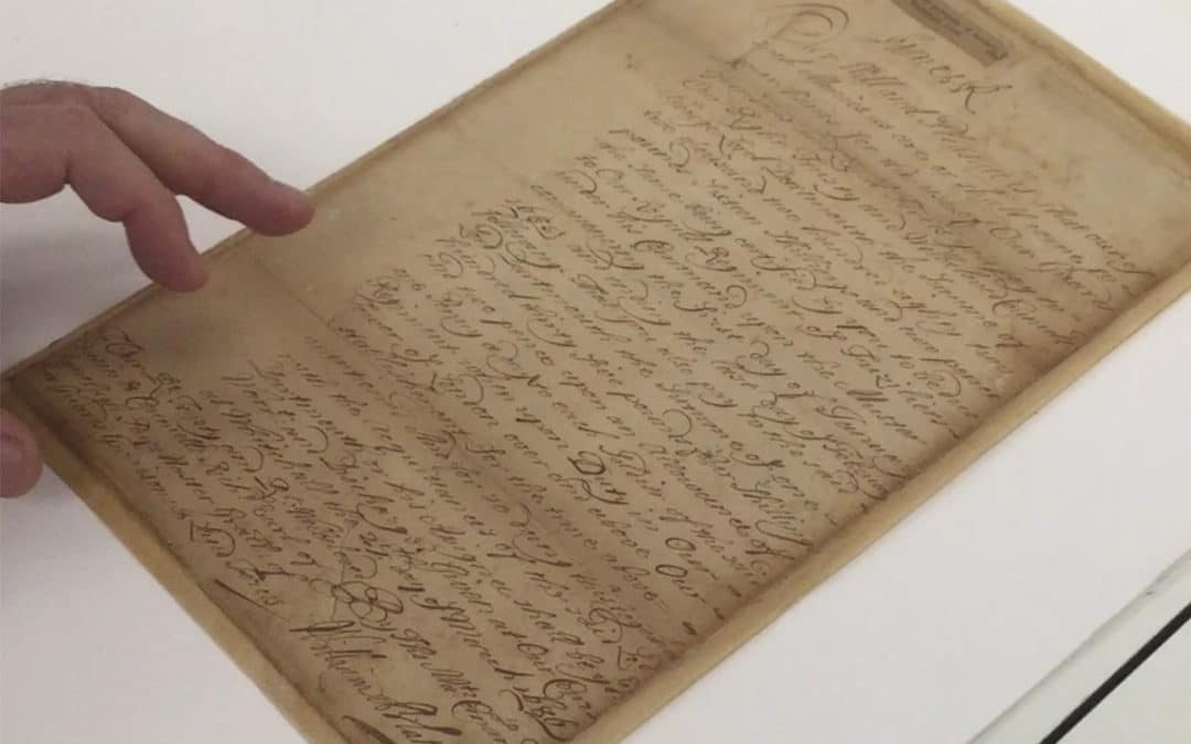 Plowden & Smith paper conservation services - James II document being examined by paper conservator