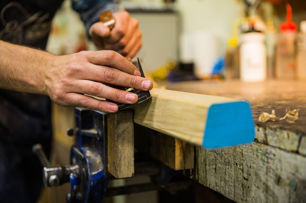 specialist furniture restorer restoring furniture in Plowden & Smith's London furniture restoration studio