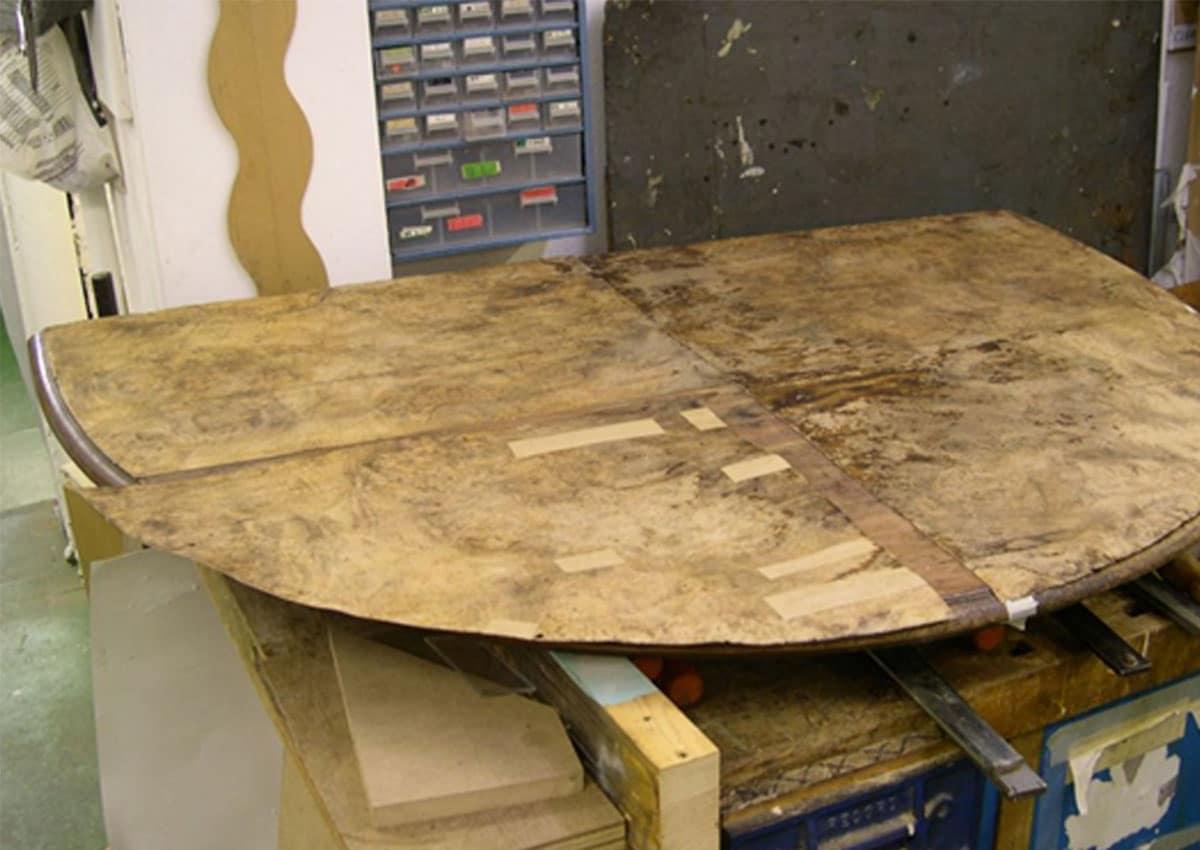 walnut dining table during furniture restoration treatment