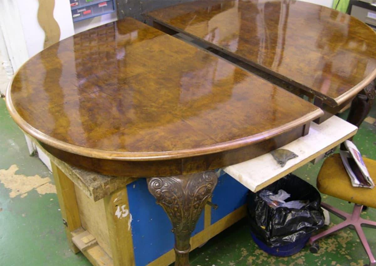 walnut dining table after furniture restoration treatment