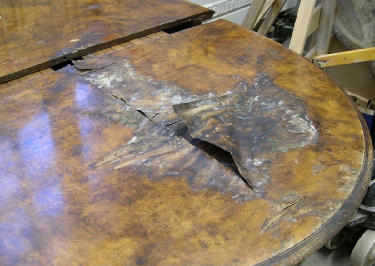 walnut dining table before furniture restoration treatment