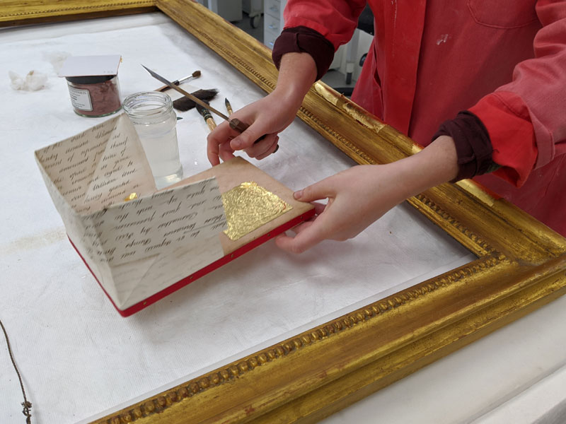 gilding gilt picture frame in the Plowden & Smith gilding studio