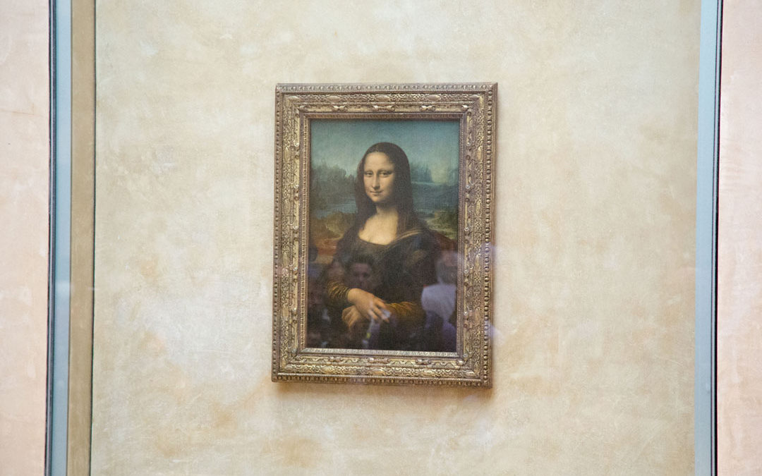 mona lisa on display at the louvre museum in paris behind bullet proof glass
