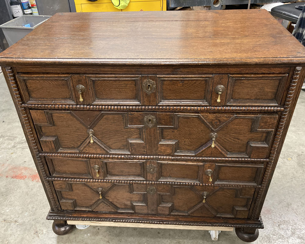 oak jacobean chest of drawers after furniture restoration treatment