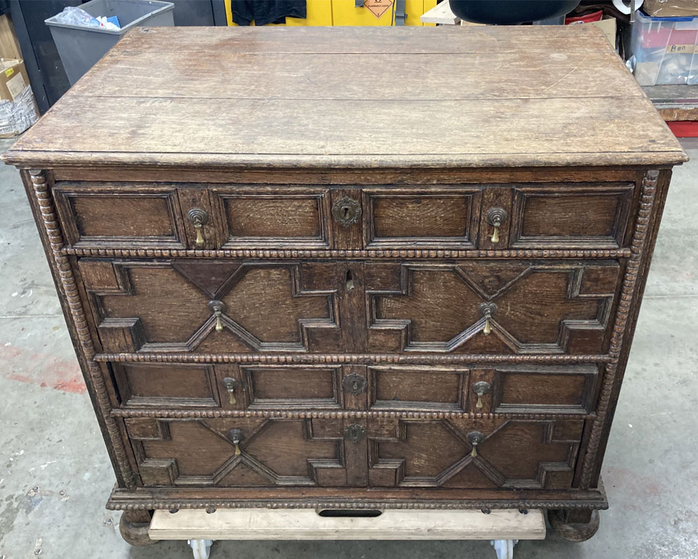 oak jacobean chest of drawers before furniture restoration treatment