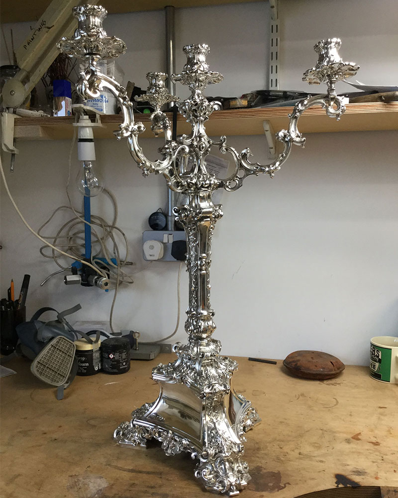 silver candelabrum after silver restoration and silver polishing treatment at Plowden & Smith